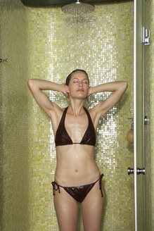 Woman taking a shower with closed eyes - FSF000392
