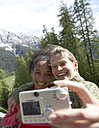 Switzerland, two happy women taking a selfie with camera - FSF000374