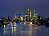Germany, Hesse, View of Frankfurt am Main, Floesserbruecke and financial district at night - AM003232