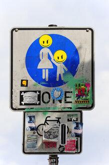 Germany, Hamburg, road sign with stickers - MIZ000762