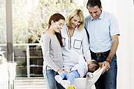 Parents and daughter looking after baby boy - GDF000583