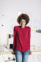 Portrait of smiling young female afro architect at her office - EBSF000363