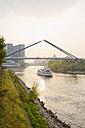 Germany, Dusseldorf, View of Dussel Rhine Estuary with brigde and ship - MEM000522