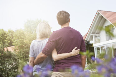 Rear view of mature couple in garden - RBF001931