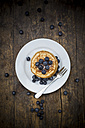 Dish with pile of pancakes, blueberries, sprinkled with icing sugar - LVF002310