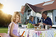 Family having lunch in garden - RBF002011