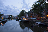 Netherlands, Amsterdam, view to boats at town canal and multi-family house in the background - FCF000482
