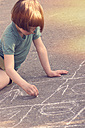 Girl drawing with chalk on road - LVF002349