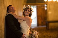 Bride and groom sharing a happy moment together - ZEF002587