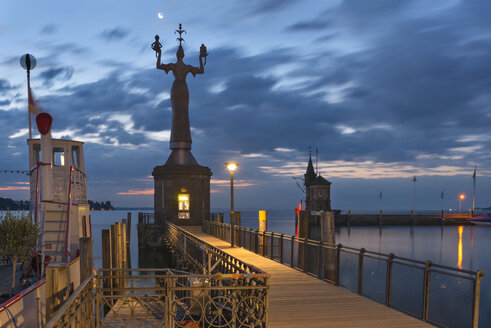 Germany, Baden-Wuerttemberg, Lake Constance, Constance, Imperia statue at harbor at dawn - SHF001691
