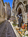 Italy, Sicily, Province of Trapani, Erice, Old town, Souvenir shop, Chiesa San Martino in the background - AMF003302