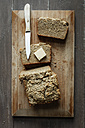 Home-baked glutenfree buckwheat bread, piece of butter and kitchen knife wooden board - EVGF001020