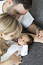 Young couple with newborn baby boy at home - OJF000079