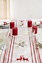 Red-white laid table at Christmas time - LVF002354