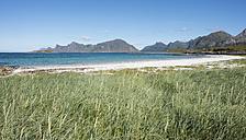 Norway, Nordland, Lofoten, Flakstad, Norwegian Sea with island of Flakstadoya - JBF000207