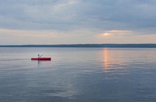 Sweden, Vastra Gotaland County, Tiveden National Park, Lake Skagern, kayaking boy - JBF000214
