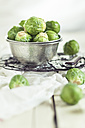 Peeled brussel sprouts in tin bucket, knife, studio - SBDF001447