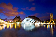 Spain, Valencia, view to lighted L'Hemisferic and Palau de les Arts Reina Sofia at City of Arts and Sciences - PU000340