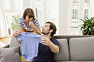 Expectant parents with blue baby shirt - FMKF001396