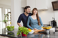 Happy couple in kitchen - FMKF001435