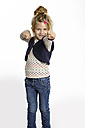 Blond little girl in defence pose standing in front of white background - GDF000624
