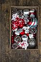 Box of Christmas decoration on dark wood - LVF002389