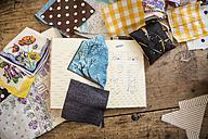 Sketchbook and cloth samples on work desk - DISF001144