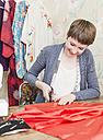 Female fashion designer working at her desk - DISF001148