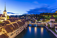 Switzerland, Bern, cityscape with Untertorbruecke, Nydeggkirche and River Aare in the evening - WDF002751