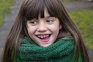 Portrait of smiling girl wearing green scarf - LVF002414