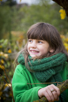 Portrait of smiling girl wearing green scarf - LVF002411