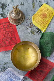 Bowl of saffron water, Tibetian bell and prayer flags - MYF000738
