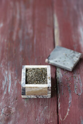 Little box of chia, Salvia hispanica, on wood - MYF000745
