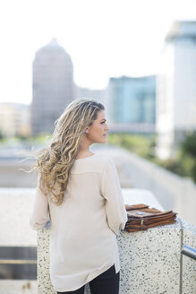 Woman with long blond hair in the city - ZEF001548