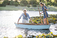 Young couple with a rowing boat on a lake - ZEF002343