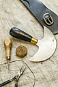 Tools on working surface in saddlery - TCF004357