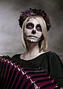 Portrait of woman with sugar skull makeup and accordion - NIF000025