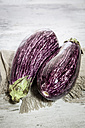 Two organic aubergines on cloth - SARF001128
