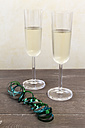 Two glasses of sparkling wine and green streamer - EVGF001409