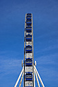 Side view of big wheel in front of blue sky - FR000146