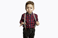 Little boy wearing suspenders pouting mouth - GDF000633