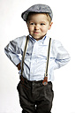 Little boy wearing cap and suspenders pouting mouth - GDF000636