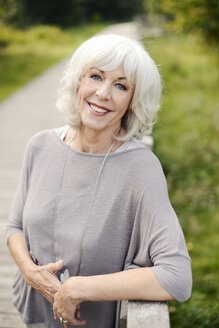 Portrait of smiling white haired senior woman - VRF000136