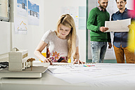 Three young architects in office - UUF002797