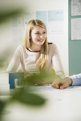 Young woman in a business meeting - UUF002818