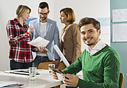 Portrait of confident businesspeople in office - UUF003006