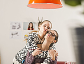 Portrait of two female friends at home - UUF002737
