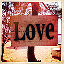 Indonesia; Bali; Gili Air; Wooden love sign on tree at beach - MMO000418