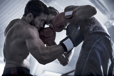 Two boxers fighting in ring - ZEF002512