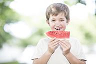 Portrait of little boy eating watermelon - ZEF002735